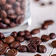 Coffee beans or grain in jar on white wooden background. Macro. - PhotoDune Item for Sale