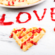 Belgian heart shaped waffle on white background. Word love made by jam. - PhotoDune Item for Sale