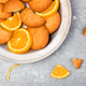 Cookies and orange citrus fruit on metal plate on grey background. Flat lay - PhotoDune Item for Sale