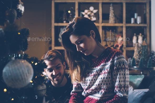 Loving couple preparing to Christmas - Stock Photo - Images