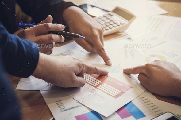 Coworkers team meeting to discuss and analysis the information together - Stock Photo - Images
