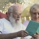 Old People Read Book in Rocking Chairs, the Husband Kiss a Wife in a Cheek - VideoHive Item for Sale