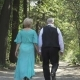 Couple of Seniors Walks Along Alley - VideoHive Item for Sale