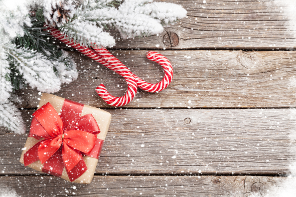 Christmas gift box, candy cane and fir tree - Stock Photo - Images