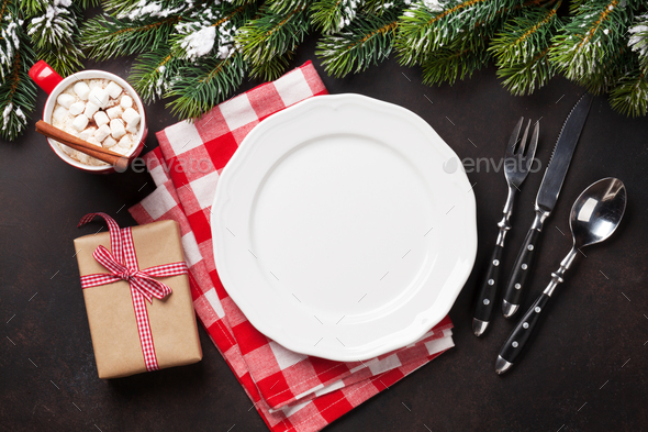 Christmas dinner plate, silverware, fir tree, gift - Stock Photo - Images