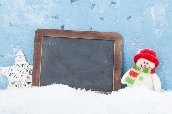 Christmas chalkboard, snowman and decor - Stock Photo - Images