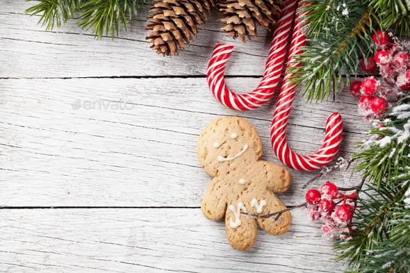 Christmas tree, candy cane and gingerbread man - Stock Photo - Images