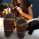 Girl Fooling Around in Christmas Socks with a Cat Lying on Bed - VideoHive Item for Sale