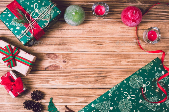 Christmas holiday gift box on decorated festive table with pine cones on wooden background - Stock Photo - Images