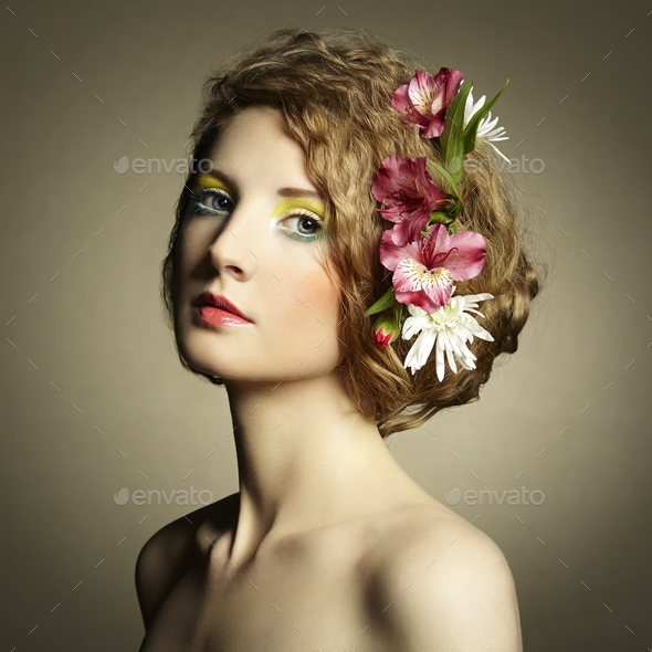 Beautiful young woman with delicate flowers in their hair - Stock Photo - Images