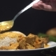 Tasty Chicken Curry, Inadian Dish with Steamed Rice. Chef Adding Chicken Curry To the Steamed Rice - VideoHive Item for Sale