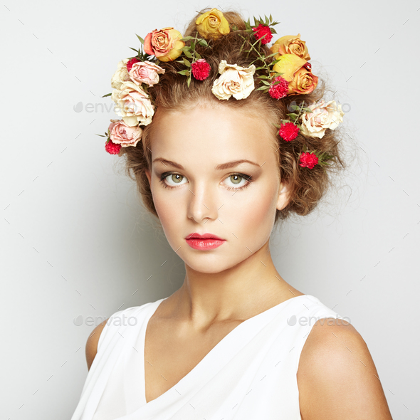 Beautiful woman with flowers. Perfect face skin. Beauty Portrait - Stock Photo - Images