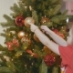 Child Decorating the Christmas Tree and Play with Ball - VideoHive Item for Sale