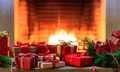 Christmas gifts on burning fireplace background - PhotoDune Item for Sale
