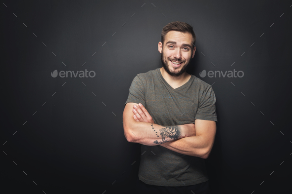 Joyful, handsome man on a black background - Stock Photo - Images