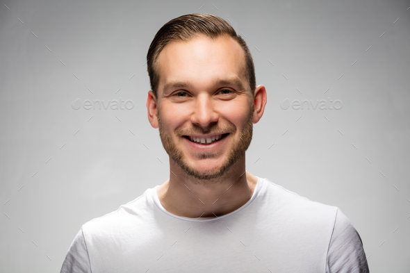 Handsome smiling man. Studio portrait. - Stock Photo - Images