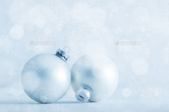 Christmas glass balls on cold frosty glitter background - Stock Photo - Images