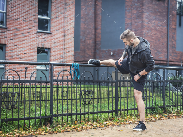 Outdoor stretching. Healthy exercising habits. - Stock Photo - Images