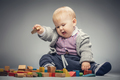Toddler boy playing with building blocks. - PhotoDune Item for Sale