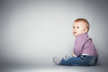 Cute toddler sitting on the floor. - PhotoDune Item for Sale