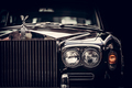 Rolls-Royce - classic British car on black background, close-up. - PhotoDune Item for Sale