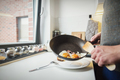 Man putting fried eggs on the plate - PhotoDune Item for Sale