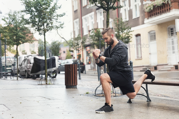 A man working out on a street - Stock Photo - Images