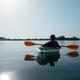 Boy in life jacket on green kayak - PhotoDune Item for Sale