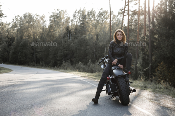 Sexy girl biker and cafe racer motorcycle - Stock Photo - Images