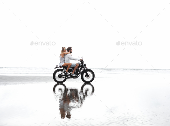 Young beautiful couple riding motorcycle - Stock Photo - Images