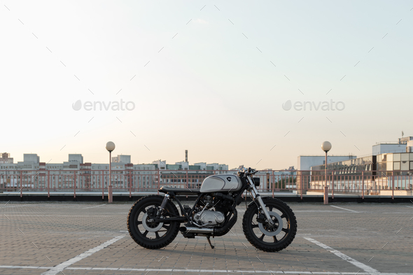 Vintage custom motorcycle on parking - Stock Photo - Images