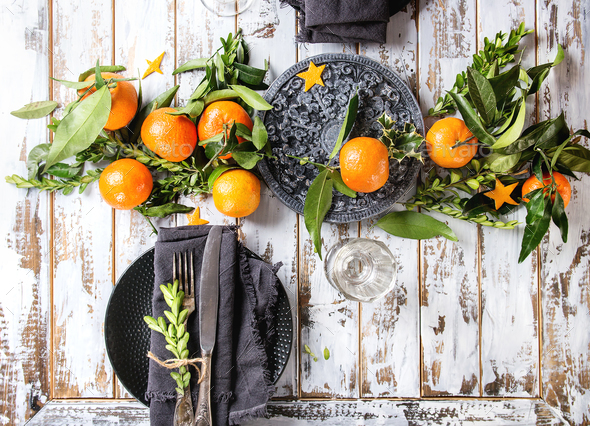 Christmas table decorations with clementines - Stock Photo - Images