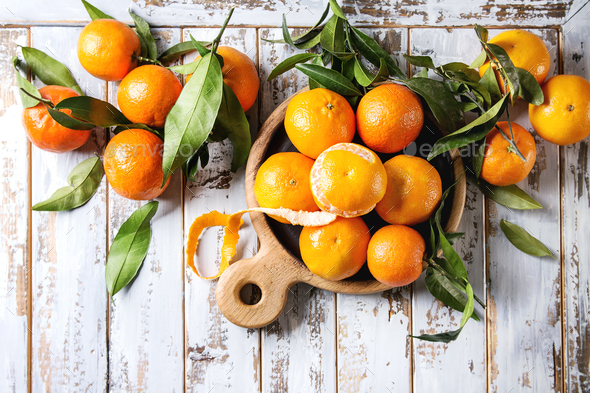Clementines with leaves - Stock Photo - Images