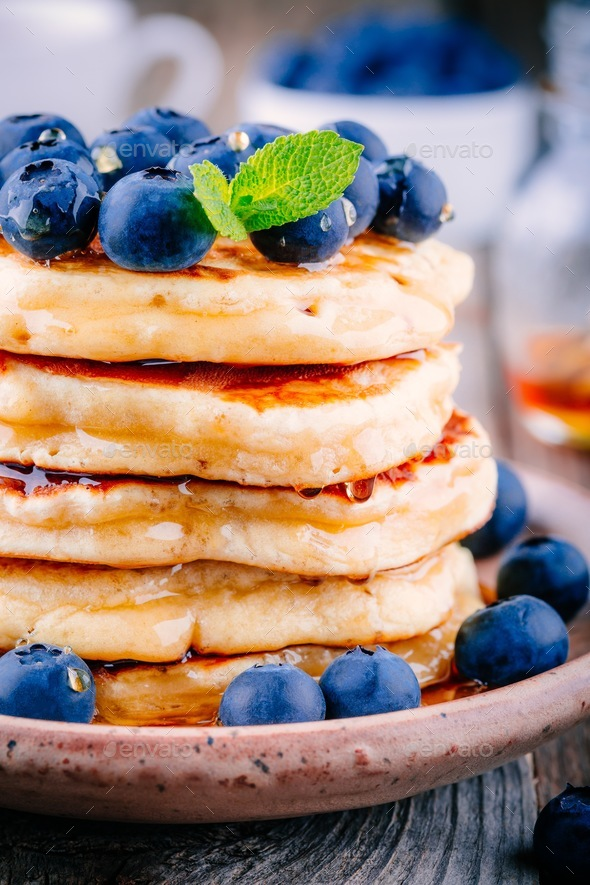 Delicious pancakes with fresh blueberries and honey - Stock Photo - Images