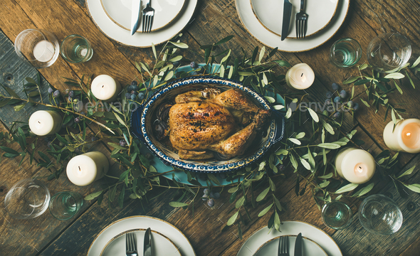 Holiday table setting for party, gathering or celebration roast chicken - Stock Photo - Images