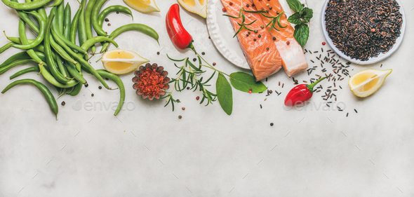 Flat-lay of raw salmon fillet steaks with vegetables, greens - Stock Photo - Images