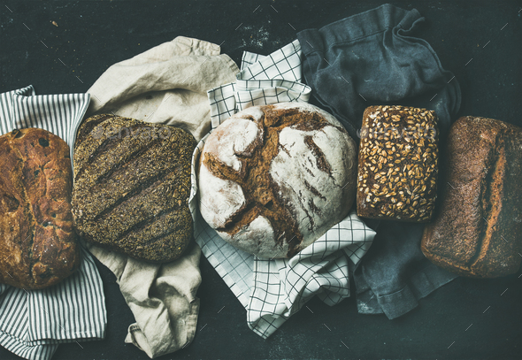 Various bread selection flat-lay, black background - Stock Photo - Images
