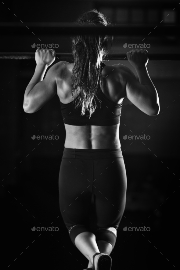 Woman athlete doing pull ups - Stock Photo - Images