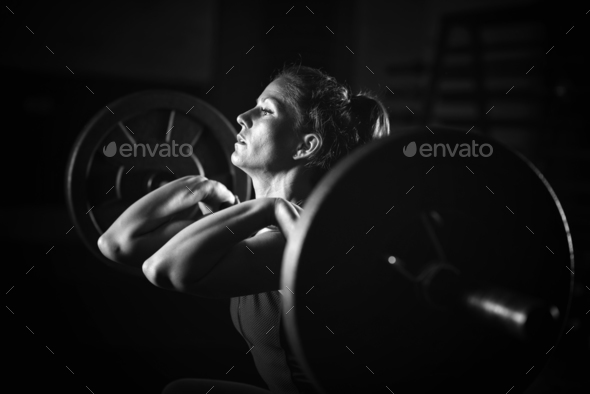 Woman weightlifting on training - Stock Photo - Images