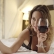 Attractive Woman Drinks Red Wine and Takes Selfie on Bed - VideoHive Item for Sale