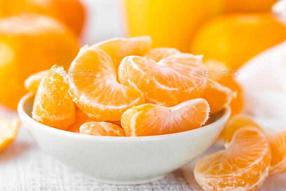 Fresh peeled mandarins, tangerines - Stock Photo - Images