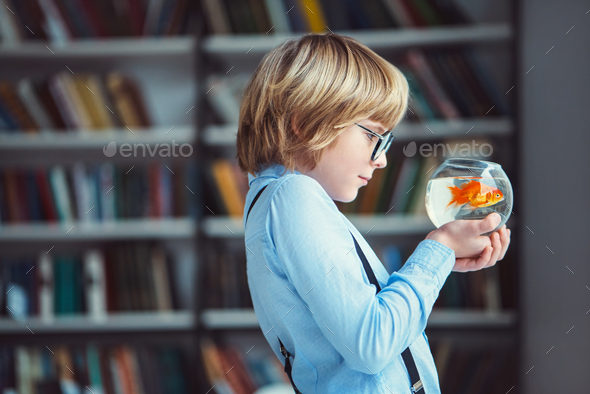 Boy with aquarium - Stock Photo - Images