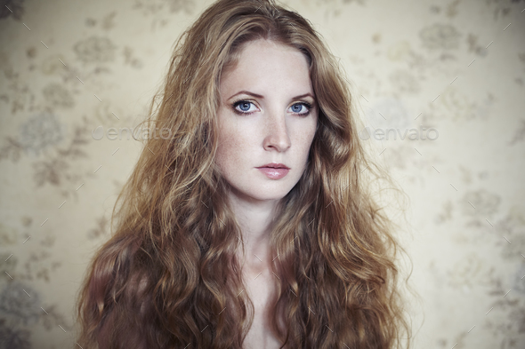 Photo of young beautiful woman with red curly hair - Stock Photo - Images