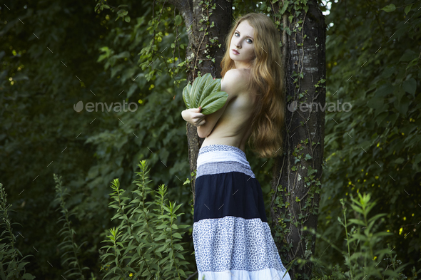 Portrait of romantic woman at the green forest - Stock Photo - Images