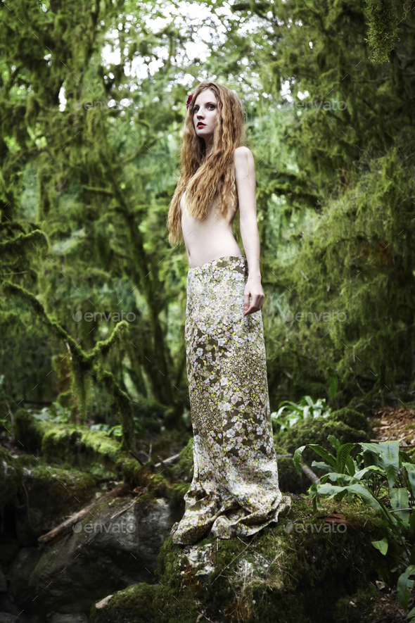 Portrait of romantic woman in fairy forest - Stock Photo - Images