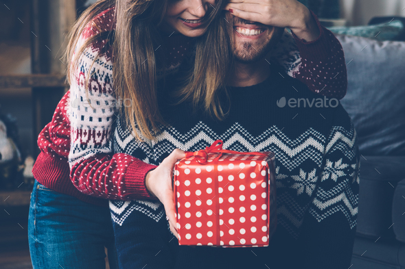 Woman giving Christmas gift to beloved - Stock Photo - Images