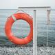 orange lifebuoy on the sea coast - PhotoDune Item for Sale