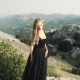 Beautiful Young Woman Model in a Black Fluffy Elegant Long Dress Posing - VideoHive Item for Sale