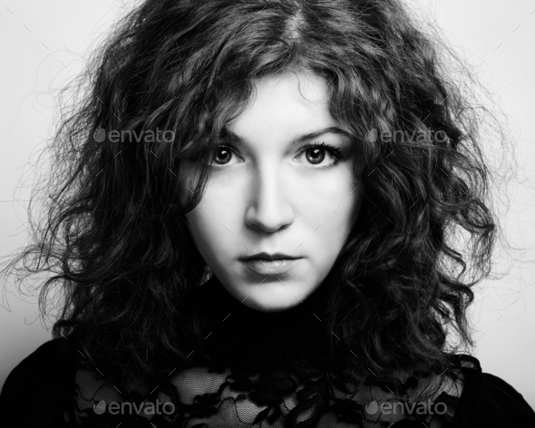 Portrait of the young beautiful woman with curly hair - Stock Photo - Images