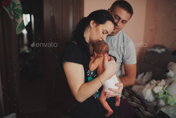 mother and father with newborn baby - Stock Photo - Images